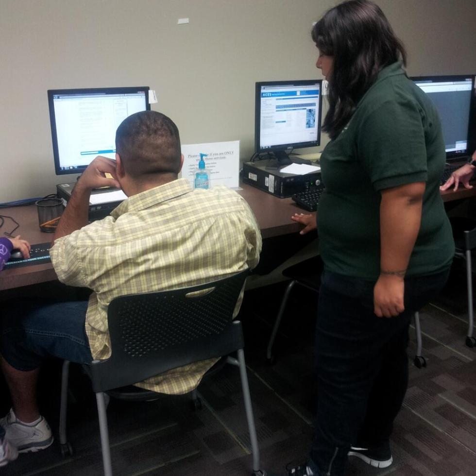 A work-study student helps another Palo Alto student. Photo by Erica Martinez.