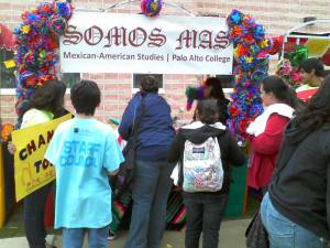 Students play the Chancla Toss at the Somos MAS booth during PACfest.