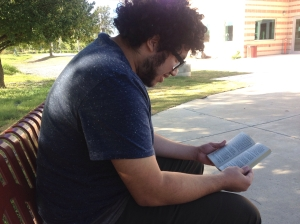 "Sophomore Education major Rudy Castillo reads ""Nine Stories"" by J.D. Salinger outside of the Ozuna Library"