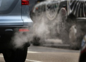 Vehicle emitting exhaust fumes on the road