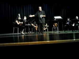 Photo of  Marion Maldonado, Tabatha Tracy, and fellow Orchestra Club members perform a concert directed by James Fort.