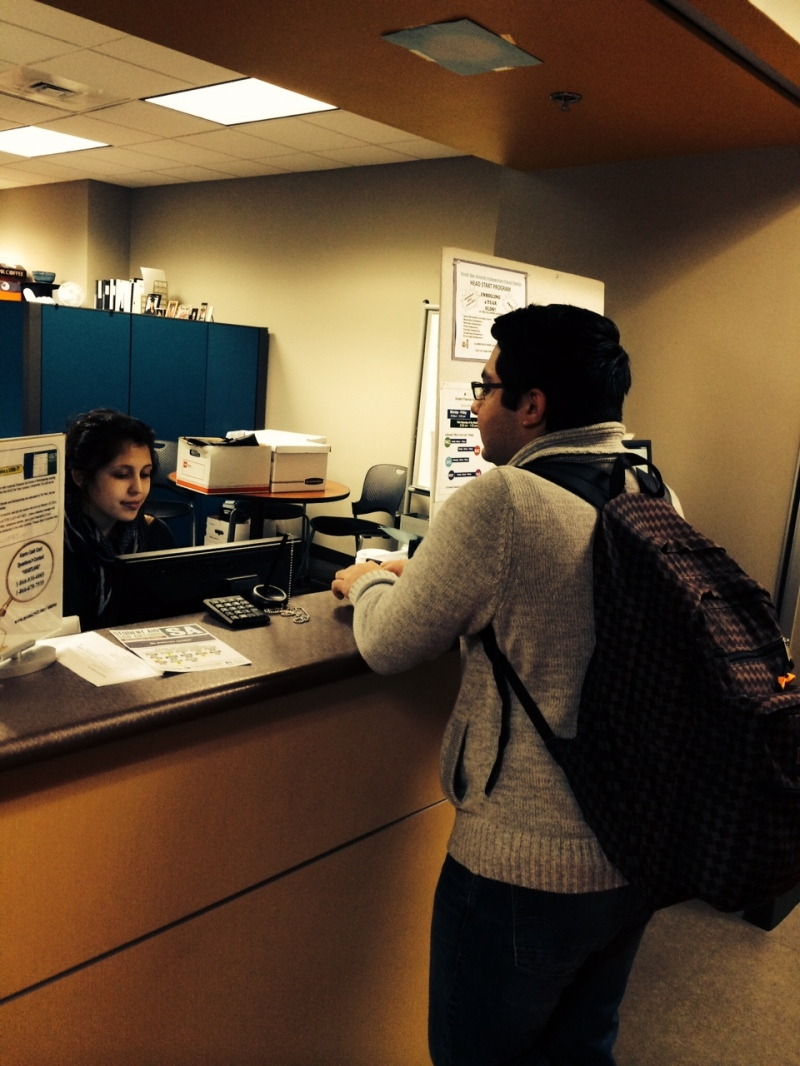 Student inquiring about financial aid assistance services