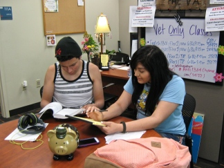 Photo of two Palo Alto College students hang out in the college's Veteran Affairs Office.