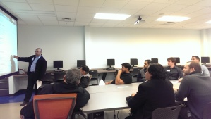 Image of PACMEN members at one of their meetings.