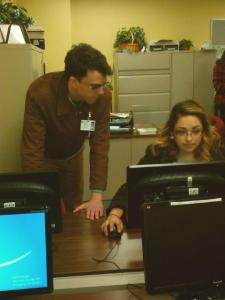 Hunter Bates, an academic program specialist helping student Yvette  Rodriguez, business management freshman in the INRW learning center.