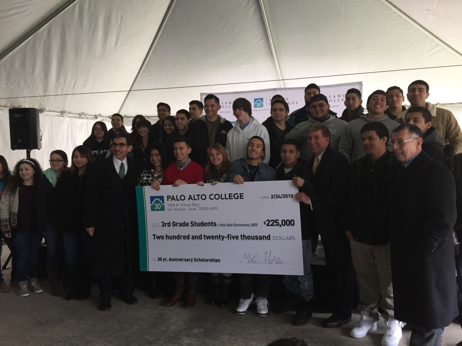 Photo of Palo Alto College President Mike Flores (left) and Alamo Colleges Trustee Joe Alderete (right) hold a scholarship check while surrounded by South San High School students.