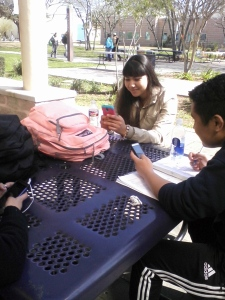 Two Palo Alto College students using mobile apps on campus Photo By: Sean Smith