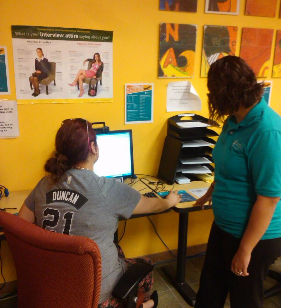 Photo of Veronica Sandoval, Peer advisor helps student use Pac Connect in the Career Service Center. Photo by Deven Malone