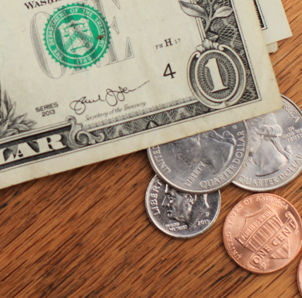 Photo of dollar bills and change