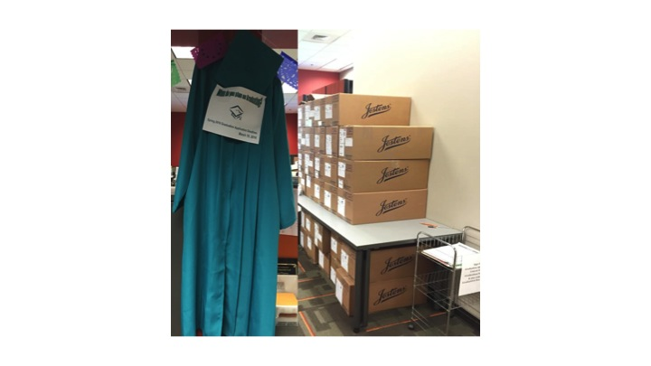 Photo of caps and gowns in boxes