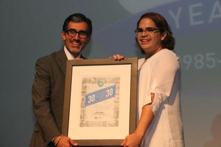 Photo of President Dr. Mike Flores presenting recipient Steven Sanchez with his plaque
