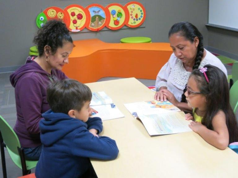 Families reading bilingual children's stories