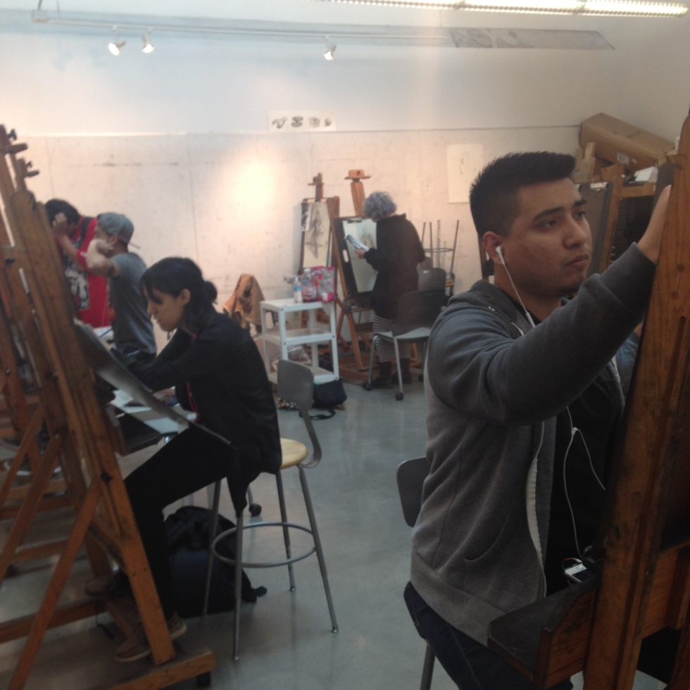 Photo of students working on illustrations in painting lab.