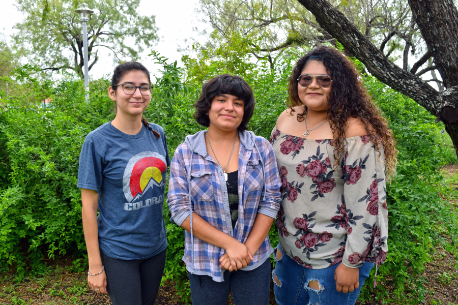 Friends Mireina Ramirez, Margarita Pereda and Amberlyn Rodriguez, Early College High School students at the Frank L. Madla ECHS, hang out at the college's Botanical Garden to study and catch up with school work.