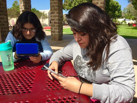 (Pictured from left to right) Evelin Ortega and Sarah Lopez play their Nintento DS games between classes.