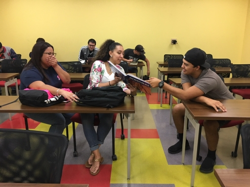 (Left to right) Students Lilliann Morales, Briana Reed and Joseph Flores laugh their way into learning in Profesora Vélez-Cobb's Spanish class, SPAN 1411.