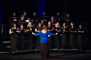 Edlyn de Oliveria, instructor of Music at Palo Alto College, leads the Palo Alto Choir during the Hurricane Harvey Relief Concert on Sept. 26, 2017.