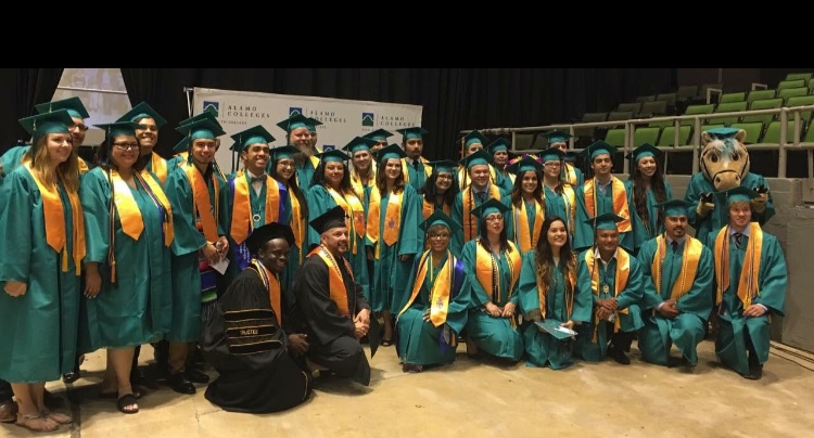 Phi Theta Kappa students show off their cords with Primo the palomino. Photo by Officer of Phi Theta Kappa.