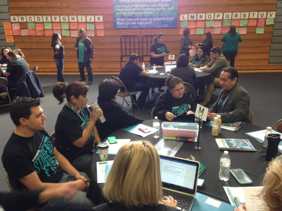 Faculty and staff gathered at a table to discuss a topic from the agenda. Photo by: Ruben Cortez