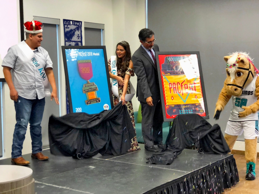 PACfest's king and queen, President Mike Flores and Primo unveil the 2018 Fiesta medal and poster. Photo by David Rojas.