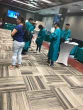 Students trying out gowns..