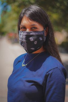 Female wearing a facemask.